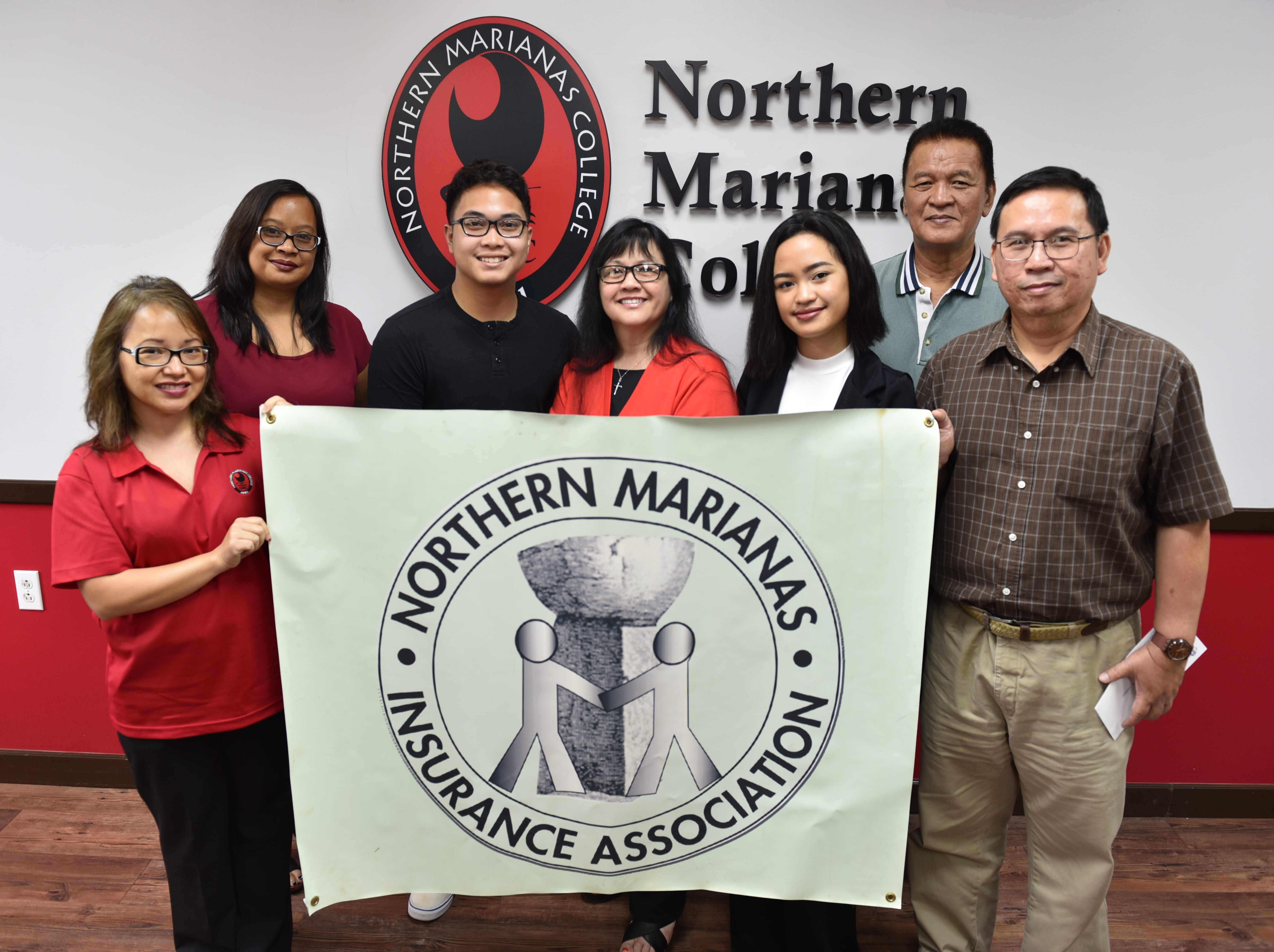 Northern Marianas Insurance Association recently awarded NMC students Michael Santos (3rd from left) and Chrystalle Lloren (3rd from right) $500 scholarships each. Also in this photo are Daisy Propst, NMC Financial Aid Director (1st from left), Jessica Sablan, Senior Underwriter of Pacifica Insurance (2nd from left), Dr. Carmen Fernandez, NMC President (center), Roberto Lloren, father of Chrystalle (2nd from right), and Gol Corpuz, General Manager of Century Insurance (1st from right).